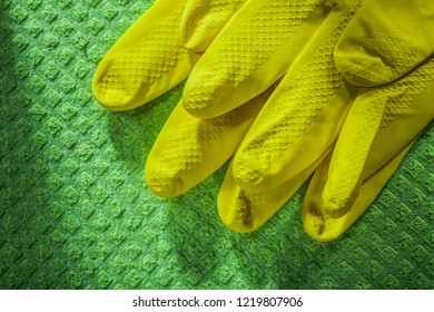Pair of safety gloves on cleaning washcloth.