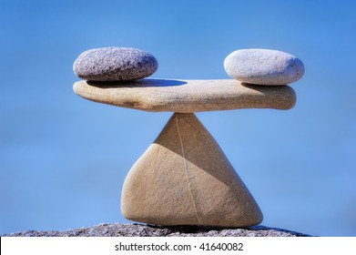 Pair of scales is made of stones on the cliff