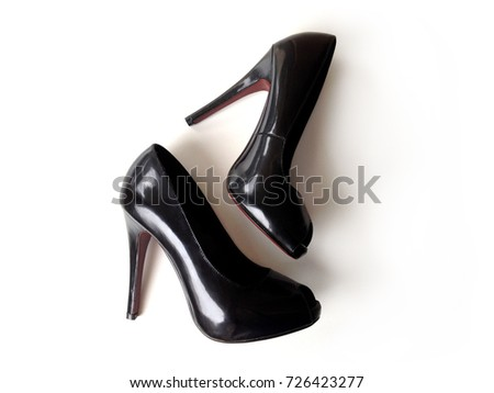 9adbb3c2f1 A pair of shiny black high spike heels with dark red sole isolated on white  background