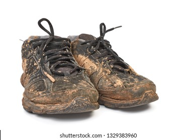 Pair of shoes covered with mud