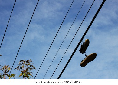 Pair of shoes hanging off the electric wires.