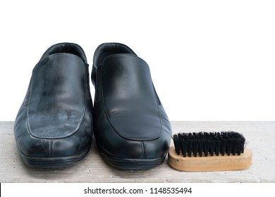 a pair of shoes made by leather with shoe brush wooden board white background isolate.Before and after shoeshine.