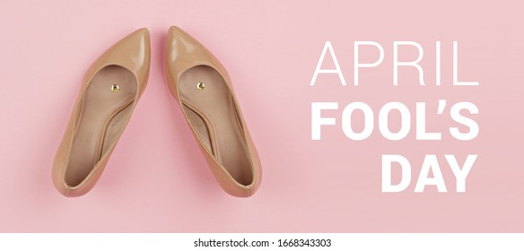 Pair of shoes with pushpin inside on pink background banner with inscription April Fools day. Pranks and tricks concept for April fools day with copy space - Shutterstock ID 1668343303