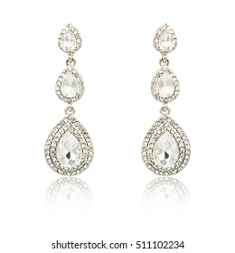Pair of silver diamond earrings isolated on white background