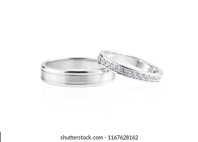 Pair of silver wedding rings with diamonds isolated on white background