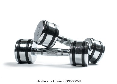 Pair of small shiny training weights isolated on white. Dumbbells