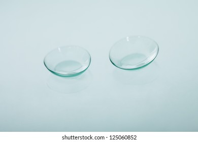 Pair of soft contact lenses lying in a concave position showing the curvature to ensure a close fit on the cornea to correct visual defects