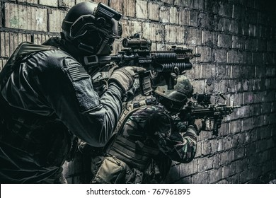Pair of soldiers in action under cover of darkness