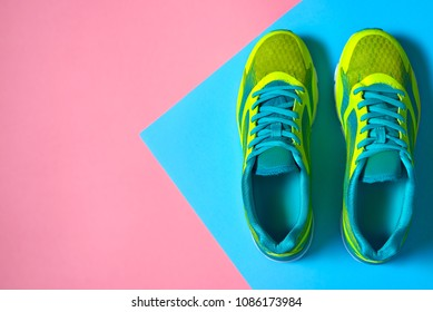 e1d9383ef Pair of sport shoes on colorful background. New sneakers on pink and blue  pastel background. Running shoes icon