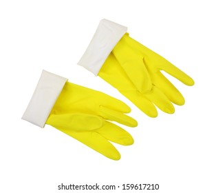 A pair of sturdy yellow latex gloves, thumbs up, cuff turned down on a white background.