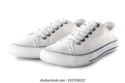 Pair of stylish gumshoes on white background