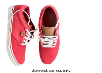 Pair of stylish sneakers isolated on white background