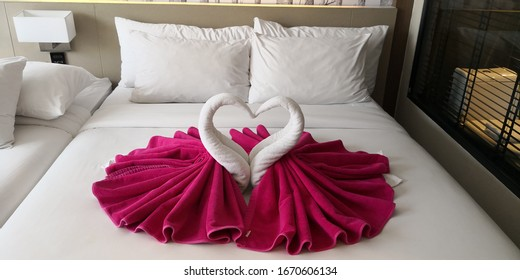 A pair of swan as bed deco in hotel