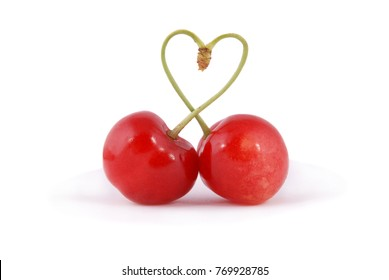 Pair of sweet cherry fruits with heart shaped stem isolated on white background