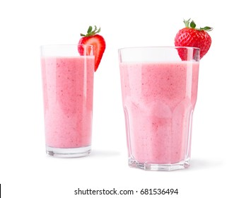 A pair of tall glasses full of sweet fruity cocktail isolated over the white background. Mixed milk shakes with bright red strawberries on the top. Healthful summer desserts.