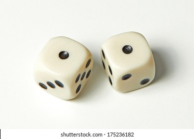 Pair of thrown dices showing two ones