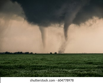 A pair of tornadoes take a destructive path through northern Oklahoma farmyards near Cherokee