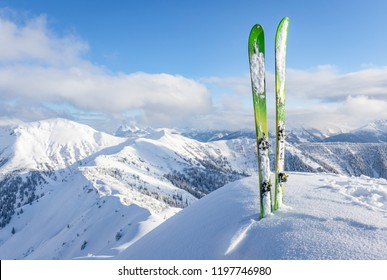 Pair of touring skis in the snow on a mountain summit