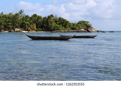 A pair of traditional pirogue fishing boats in the calm waters surrounding Île Sainte-Marie, Nosy Boraha Island, Madagascar, East Africa