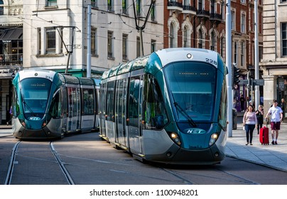 Pair of trams passing in the old market square, taken in Nottingham, Nottinghamshire, UK on 24 May 2018