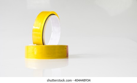 Pair of a transparent, moisture proof adhesive material cellophane tape. Isolated on empty background. Slightly de-focused and close-up shot. Copy space.