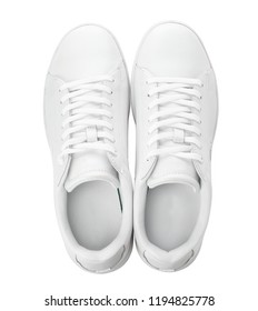 Pair of trendy sneakers on white background, top view