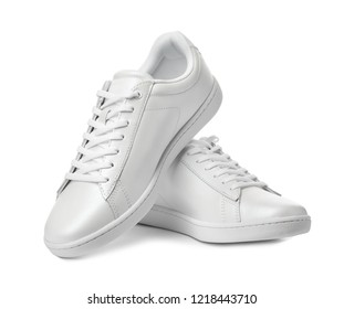 Pair of trendy sneakers on white background