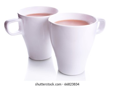 Pair of two white office cups of coffee with milk isolated on a white background