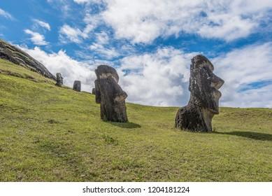 Pair of underground moai on the extinct volcano Rano Raraku
