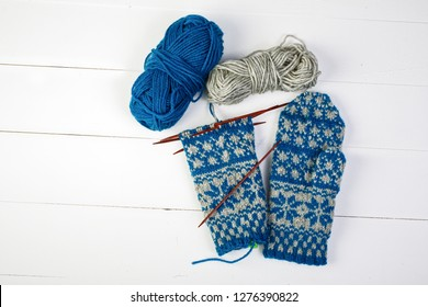 A pair of unfinished Scandinavian inspired stranded colorwork knitted mittens.