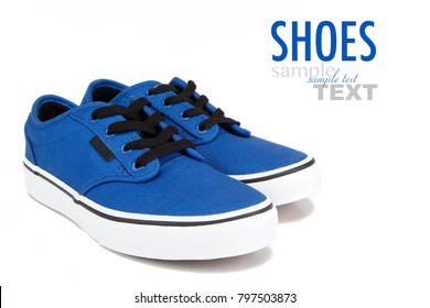 A pair of vintage blue canvas sneakers with black laces. Shoes shot in studio on a white background with sample text.