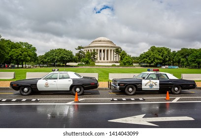 Pair of vintage California Police Cars parked outside The Jefferson Memorial in Washington DC, USA on 13 May 2019