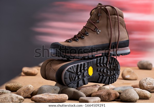 Pair of walking boots in the studio