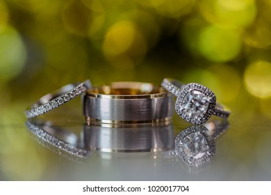 A pair of wedding rings with bokeh background