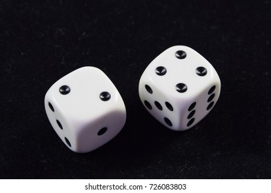 A pair white of dice showing Four and Two