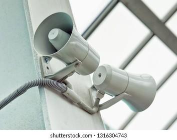A pair of white loudspeakers.