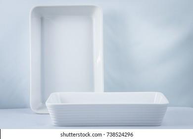 Pair of white pirex on a bluish background