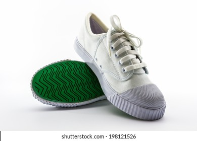 Pair of white sport shoes on white background.