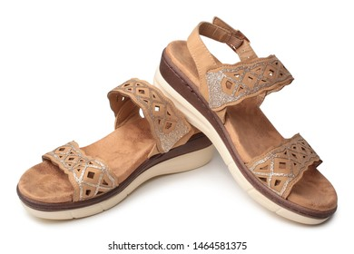 Pair of woman's summer sandals on white background
