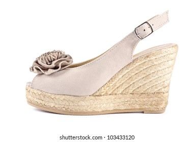 e875068ba Pair of Women's Neutral Suede Wedge Sandals Isolated on White