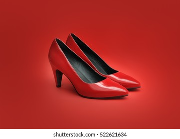 Pair of women's red pumps on red background.