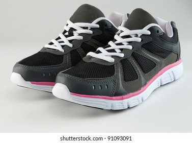 pair of women's sneakers on white
