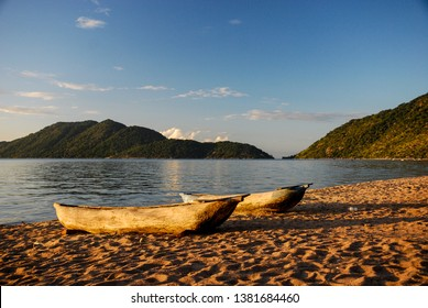A pair of wooden canoes on the edge of the water of Lake Malawi, Malawi
