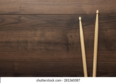 pair of wooden drumsticks on wooden table