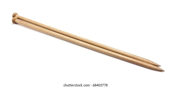 A pair of wooden knitting needles isolated on white.