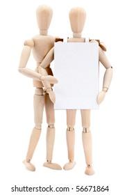A pair of wooden people wearing a sandwich board.
