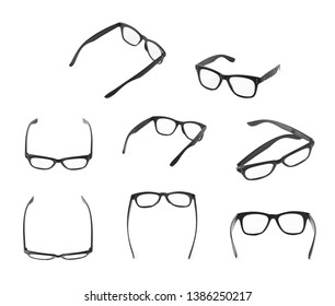 Pair of wooden textured optical reading glasses isolated over the white background, set of multiple different foreshortenings