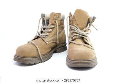 A pair of work boots isolated on a white background.