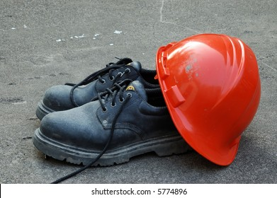 A Pair of Work Shoes and a Hard Hat