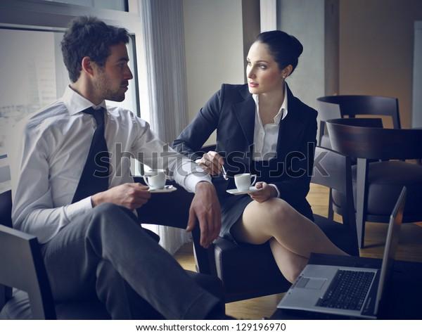 pair of workers talking in coffee break